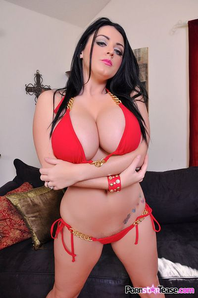 Sophie Dee shows off her massive boobs before starting to play with her pussy