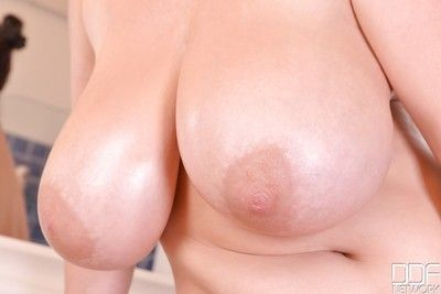 Chubby Euro babe Joanna Bliss revealing massive MILF hooters in bathroom