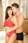 The throbbing hard stick is sliding in and out busty milf Lisa Ann's pussy