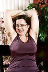 Brunette plumper flashing hairy armpits before unveiling beaver