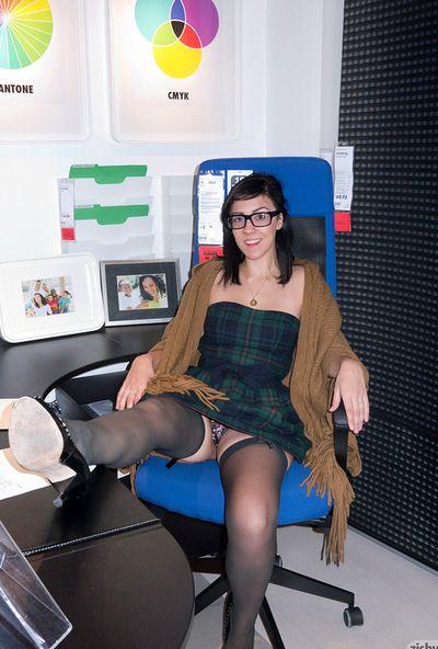 Brunette babe with sexy glasses Aysha Thoen enjoys flashing her fantastic panties