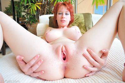 Redhead uses a huge apparatus jock to please her naughty porn desires