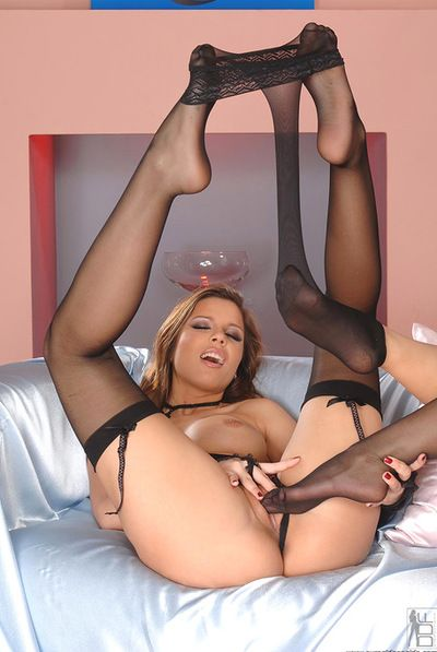 Enthralling blonde youthful in black nylons is thankful her in nature