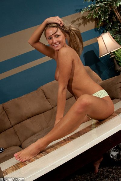 Youthful first timer Kendra Rain sliding strings over glamorous legs