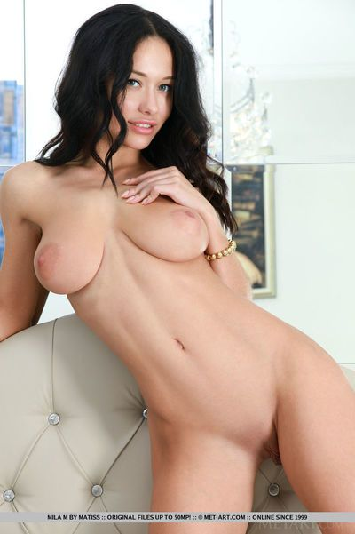 Dark hair babe Mila M freeing vast amateur tits from lingerie in stockings