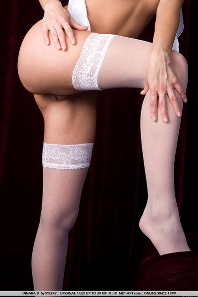 Luscious cutie Dinara Nubiles in white stockings is caught in a without clothes posing session