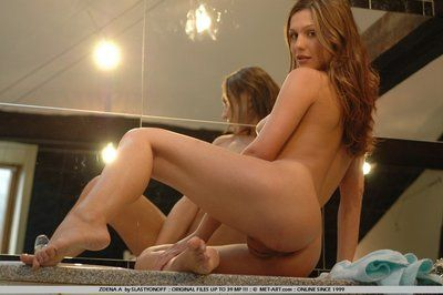 Red haired hottie Zenia Legal age teenagers plays in the bathroom watching herself in the mirror