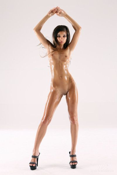 Oiled up solo brunette chicito Nika Nikola is amplifying her buttocks to show the goods.