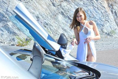 Fascinating beauty Riley Reid with elegant legs takes off her advisable shorts in a car