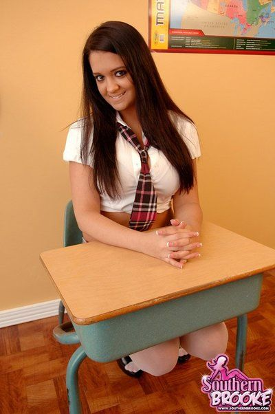 Frisky schoolgirl Southern Brooke shows her big tits and sexy buttocks not including removing her uniform.