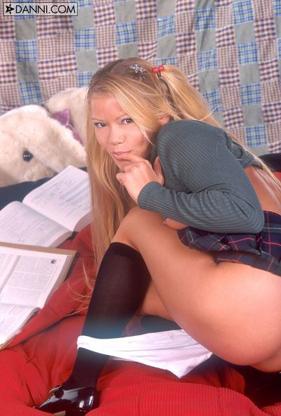Merry schoolgirl Julie Meadows lifts up her ebon short skirt and draws off her white shorts