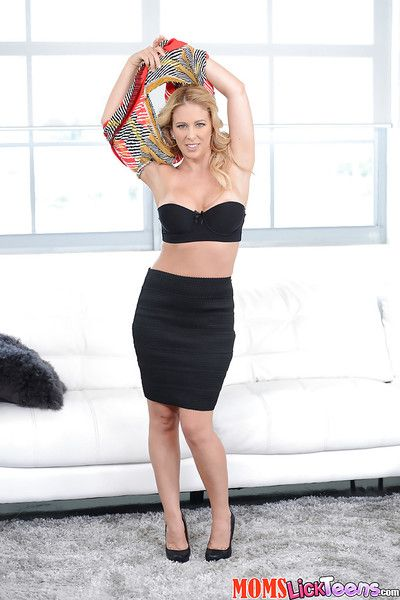 Older blonde MILF Cherie Deville removing short skirt for stretching of pussy