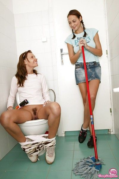 Appealing teenage sweeties have some lesbian fun in the restroom