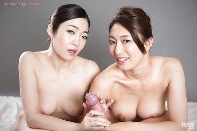 Unclothed Japanese nubiles with great boobs jerk off large cock and kiss