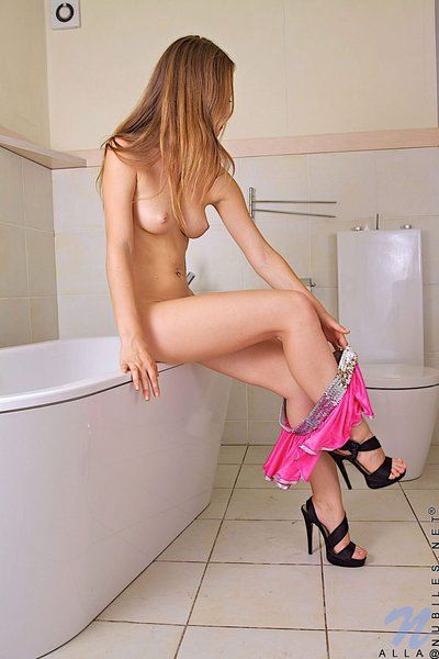 Tall covert legged teen Alla Teens with lively meatballs exposes her slit in the bathtub