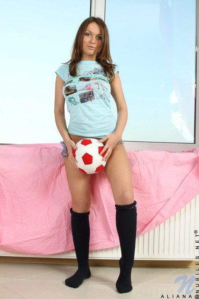 Soccer loving stacked young Alice Miller in knee high black socks disrobes to show her cage of love