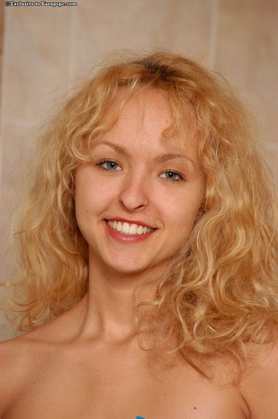 Smiley juvenile blondie with slim curves undressing and taking shower