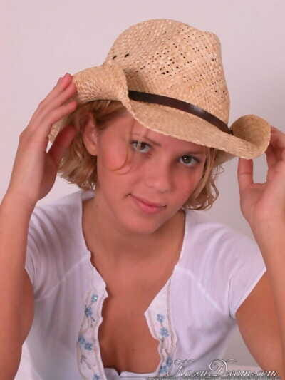 Teen first timer peels off jeans ahead of covering her uncovered tits with straw hat