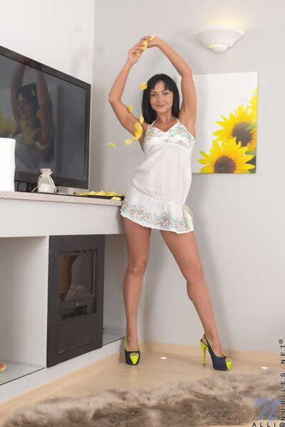 Dark haired college student Alli doffs satin underware and heels to case nude