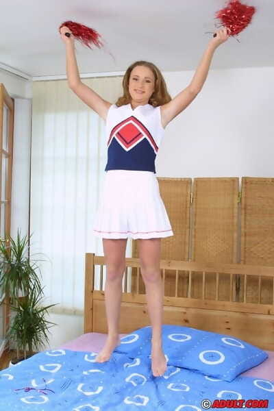 Chippy teen cheerleader unhurriedly uncovering her tempting bends over