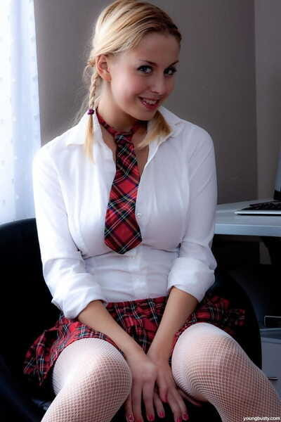 Adolescent and busty blonde removes schoolgirl uniform prior to a hard fuck