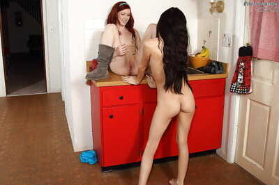 Extreme redhead young purchases her cum-hole licked by her lesbian collaborator