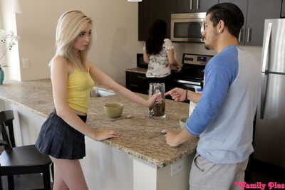 Youthful blonde girl benefits from a creampie from her stepbrother in the kitchen