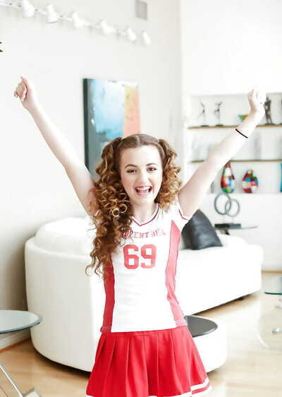 Barely legal teenager Marissa Mae posing in stunning cheerleader uniform