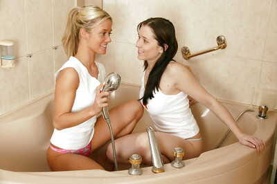 Lusty infant lesbian chicks licking and toying all the time others slits in the bathroom