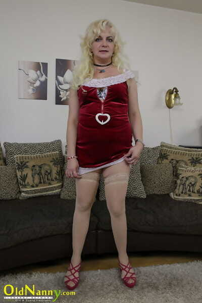 Busty granny stripped off to her stockings ahead of toying and fingering her pussy