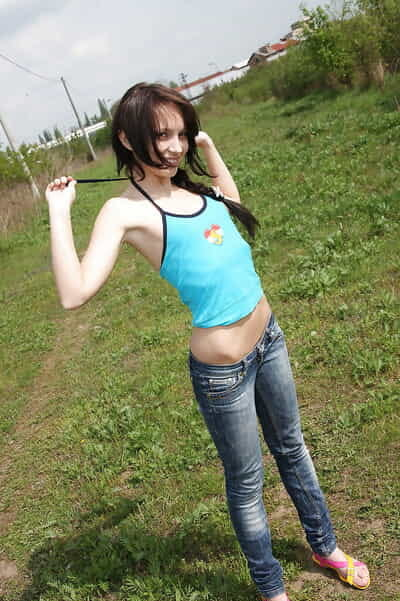 Sweaty adolescent Nataly B exposing her body and toying her holes outdoor