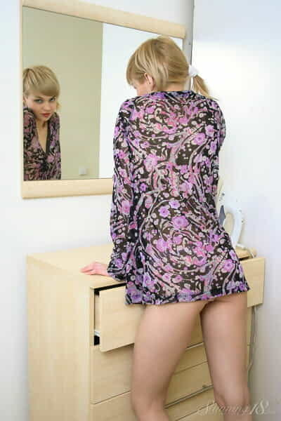 Adorable Young year old Cindy B gets bare on a dresser afore a mirror