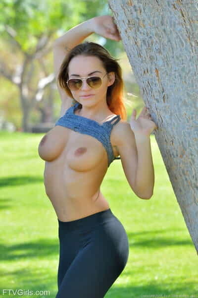 Sports girl Charlotte disrobes her athletic costume for a naked public romp