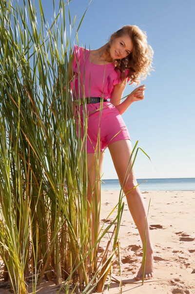 Leggy teen Patritcy A masturbates at the same time as waste as mother gave birth behind tall beach grasses