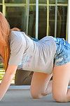 Lewd redhead likes to tease and impress with her nude forms