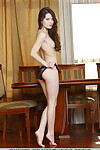Leggy teen Amelie B removes brown underclothing to sample stripped at a dining table