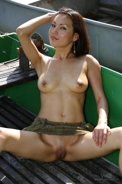 Outdoor Chinese Annie Ling covered merely in diminutive short skirt expands her legs and shows her tightest snatch