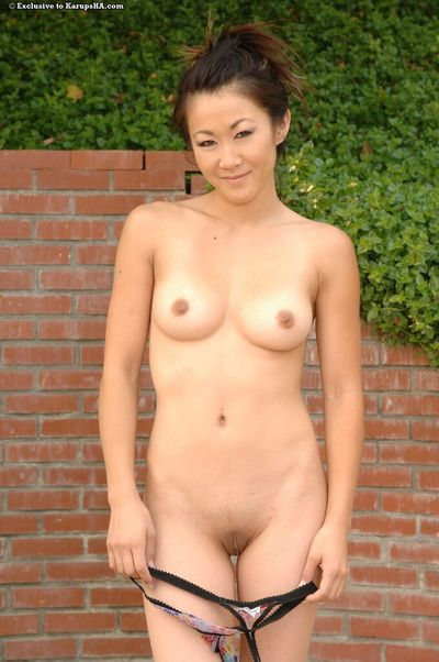 Sporty oriental babe Taya Talise with smooth head vagina takes her clothes off not featured her tense uniform outdoors