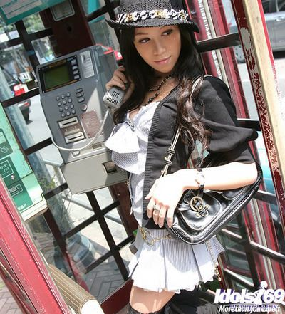 Graceful oriental adolescent fashionmonger erotic dancing off her garments