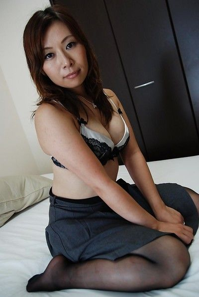 Japanese MILF Machiko Nishizaki undressing and exposing her inviting twat
