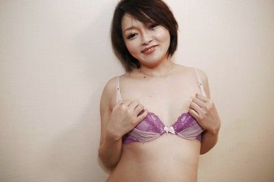 Eastern mama Mika Aoto gets undressed off pink underclothing to wank hirsute cage of love