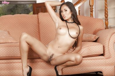 Spectacular dark brown Japanese Beverly is expanding her appealing legs