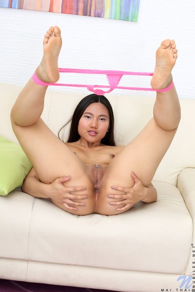 Chinese young Mai Thai sheds underclothing to expand arse & disclose hairless wet crack cameltoe