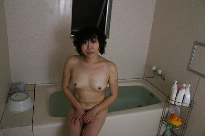 Japanese milf Yoshiko Sakai takes a shower-room and demonstrates undersize zeppelins