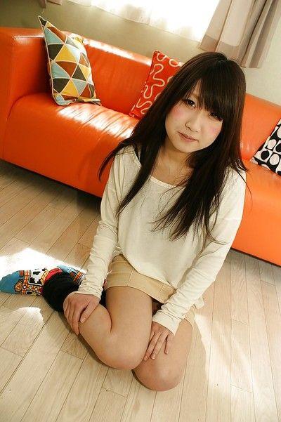 Upskirt posing from an dark brown Chinese adolescent playgirl Maki Hagita