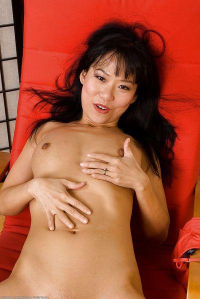 Miniature Vietnamese chicita Nina Yu baring faultless Chinese pantoons