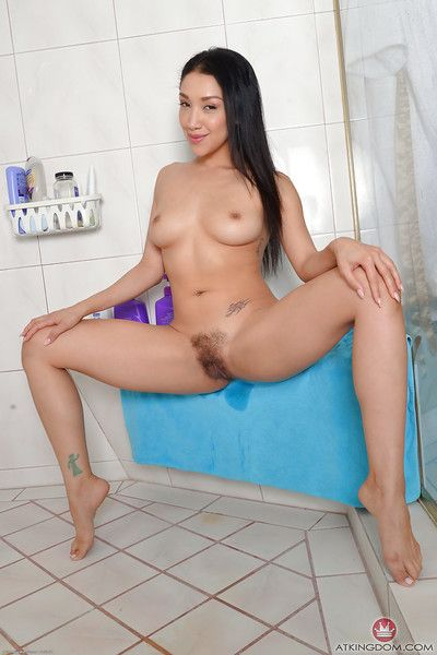 Appealing Oriental angel Vicki Go after freeing shaggy bush from underclothes in bathroom