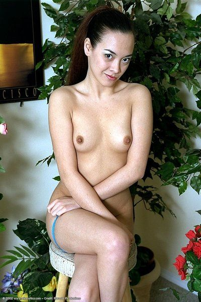 Young Chinese exemplar Womanlike exposing compact bumpers and bushy snatch outdoors