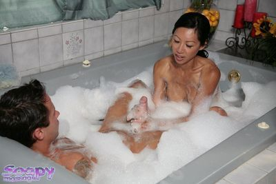 Oriental milf with huge mangos Tia Ling is playing with heavy member in the foamed bathroom