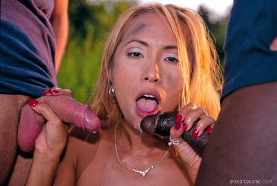 Nasty red haired Japanese engulfing a brown and a white dick in int